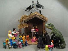 Nativity scene with Angel Batman, Shepards Bill and Ted, Three Wise Vaders, Ryker and Deanna Joseph and Mary, plus a T-Rex barnyard animal.