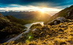 Unique sunrise view in the mountains of Fiordland, New Zealand.  The only way to get up there is by helicopter - I had an amazing view on the sunrise over Fiordland. The Norwest Lakes were sparkling in the early morning light and the Sun dyed everything deep orange after rising over the peaks.  The Lord of the Rings producers liked and filmed beside these high alpine lakes too. One of the most stunning places I've ever been!