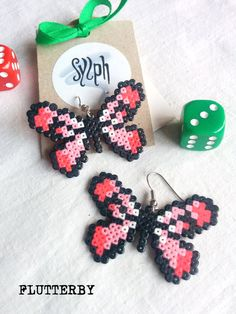 Baby pink pixelated Flutterby earrings made of Hama Mini Perler Beads in 8bit retro gamer style, for those butterfly lovers! by SylphDesigns