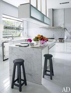 Accessories designer Nancy Gonzalez's kitchen features a Bulthaup hood, Wolf range, and Thassos marble floor.