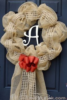 This wreath combines gathered mesh fabric with a geometric ribbon accent for a new take on traditional burlap decor. Get the tutorial at Decor Chick »  - GoodHousekeeping.com