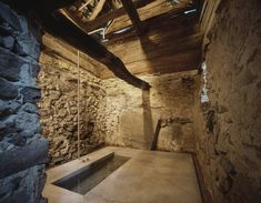 A 200 year old existing stone house in Linescio, Switzerland was renovated by Buchner Bründler Architekten with a distinctive, minimalis. Old Stone Houses, Old Houses, Swiss Chalet, Tadelakt, Exposed Concrete, Underground Homes, Bad Inspiration, Architectural Section, Modern Bathrooms