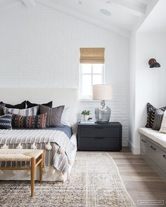 Bohemian bedroom ideas with hardwood flooring and large area rugs.   How to add bohemian design to your master bedroom   mix and match mudcloth pillows