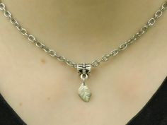 Necklace with leaf pendant from re-used necklaces, chains, and a charm