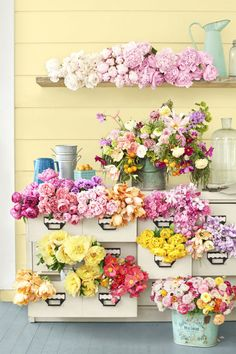 Empty Drawers:  For a show-stopping spring display, let blooms spill out of the drawers of an old card catalog or school cubby.