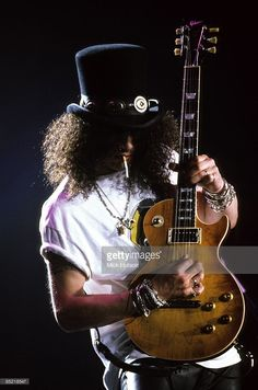 ARENA Photo of GUNS & ROSES and SLASH and GUNS N' ROSES and GUNS AND ROSES, Slash performing live onstage, playing Gibson Les Paul guitar, at Gibson Night Of 100 Guitars, wearing hat