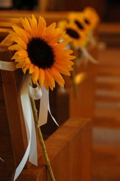 sunflowers tied to the pews