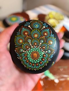 dot day art projects A large wooden Mandala Stone. This is the first time I have not used a natural stone for my painting but round stones are so hard to find or totally uneven! Rock Painting Patterns, Dot Art Painting, Rock Painting Designs, Mandala Painting, Pebble Painting, Pebble Art, Stone Painting, Mandala Painted Rocks, Mandala Rocks