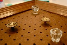 Jewelry organizer - screw decorative knobs into a framed pegboard! I would even paint the pegboard to look prettier!!!