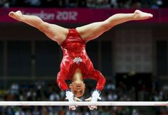 Canada's Victoria Moors performs on the asymmetric bars during the women's gymnastics team final in the North Greenwich Arena at the London 2012 Olympic Games