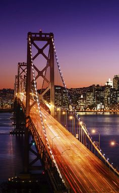 Be sure to add San Francisco and Napa Valley to your Coastal California Road Trip plans. This photo: The San Francisco skyline and Bay Bridge at sunset.