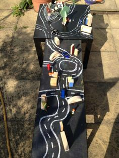 Roadways on the chalkboard tables with blocks, vehicles and more chalk for adding additional details - The Imagination Tree ≈≈