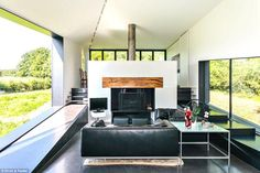 The feature fireplace is the focal point of the open plan living area on the upper floor of the property