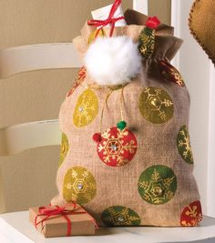 A burlap Santa bag is a cute holiday decoration for under the tree! #fabulouslyfestive