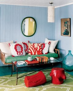 Get a beachy feel from accessories like coral pillows and a bamboo-inspired glass-topped table.