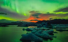 Filmmaker Henry Jun Wah Lee captured footage of a volcano erupting during a recent solar storm over Iceland.