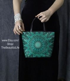 This bag is constructed from a fabric print of one of my original Chakra Mandalas. The mandala is custom printed onto heavy polyester fabric for sharpest image, most vivid color reproduction and durability. Finished with black leather detailing along the top zipper closure and a black leather box bottom. This bag comes in two sizes and is part of the Anahata Mandala series.