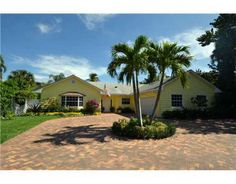 Beautifully renovated 3 bedroom / 2 bathroom home steps from the beach in Ocean Ridge listed for $1,075,000