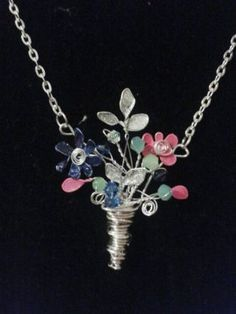 Bouquet of flowers necklace , made with beads, wire and nail polish. This gives me an idea for a necklace using a chain with crystals that I have Aluminum Wire Jewelry, Handmade Wire Jewelry, Resin Jewelry, Wire Wrapped Jewelry, Beaded Jewelry, Jewellery, Nail Polish Flowers, Nail Polish Jewelry, Nail Polish Crafts