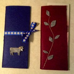 A couple felt tract holders that a sister from Switzerland gave my wife and I at the International Convention this past weekend in East Rutherford. The blue one has a grey felt cow with a tiny bell on the neck.