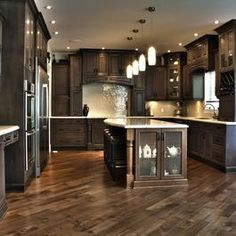 Wow I love this kitchen!!! The floor is laid on an angle and is lighter than cabinets. I could use the iridescent white tiles for backsplash. Love the light counters with dark cabinets!!!!