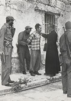 Condemned former Batista army corporal José Rodríguez receives last rites from a priest at Matanzas, Cuba (1959) … Andrew Lopez, of United P...