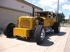 What's black, yellow and 8,000 pounds? Jim Schomaker's half Studebaker, half Caterpillar excavator truck! From the Detroit News.