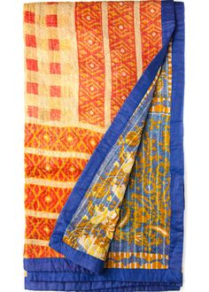 These beautiful lightweight throws are hand-stitched with vintage Indian sari fabrics in the traditional Kantha style. Each throw is completely unique and beautiful! They are reversible and vary in co