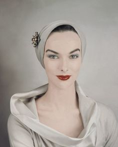 Victoria von Hagen, April 1954 | Victoria is wearing a beige close fit turban pinned with diamond and amber brooch and cowl neck beige silk blouse.   Image by Condé Nast Archive/Corbis