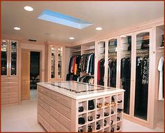 oh if only i had all the money in the world to build myself a home. maybe someday, and my closet will definitely look like this!