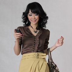 Brown cotton blouse with three-quarter roll up sleeves. Ruffled accents at front with front opening buttons. $22