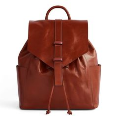 This slouchy leather backpack develops a patina that gets more lovely with age. Just like the women we love.