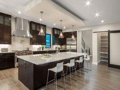 white countertops + dark cabinets + light wood floor BKC Kitchen & Bath | Kitchen Remodel Portfolio
