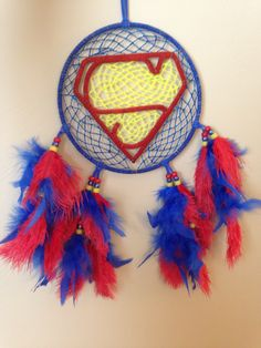 "7"" superman style dream catcher. Yellow web glows. $23 available on eBay."