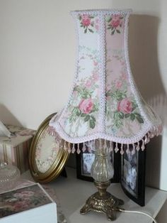 Pink and beaded shade. Love this lampshade and the vignette.