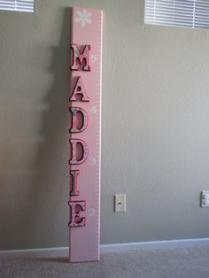 Adorable wooden growth chart with custom lettering.  So cute!