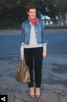 The faded denim jacket is a great compliment to this business casual outfit of simple black slacks and a white sweater. Although I am unsure I would wear it I love the pop of color with the pink scarf. I absolutely adore the copper bag and shoes to round out the outfit.