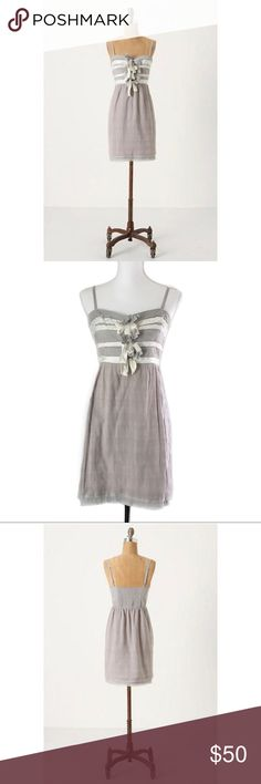 """Feather Bone Sweet Offerings Dress As seen on GLEE Grey and white Feather Bone dress from Anthropologie. This dress has a pullover styling and elastic in the back for the perfect fit. Thin linen like material, layered skirt with raw edging, knotted bows at bust, and adjustable straps. 100% Cotton. Worn by """"Quinn Fabray"""" on an episode of Glee.  *All measurements are approximate*  Length: 27.5"""" (Not including straps) Bust: 17"""" laying flat Waist: 15"""" laying flat Anthropologie Dresses"""