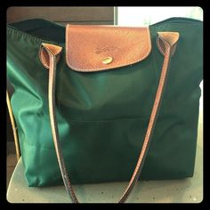 Long champ Authentic Hunter green SMALL size excellent condition bought it but is small for me am use to large sizes .9.75lLx 10h x5 W last pic is measurements from Neiman Marcus this is there medium. Longchamp Bags Totes