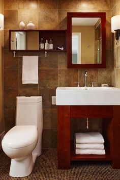 single vanity bathroom - I like the towel bar hanging from the shelf and the tile on the wall (but not much else) too modern for me Bathroom Vanity Storage, Single Bathroom Vanity, Tan Bathroom, Bathroom Vanities, Vanity Room, Modern Bathroom, Vanity Cabinet, Basement Bathroom, Bathroom Cabinets