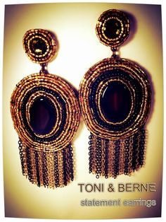 Statement Flair  Now this is what we call a fabulous statement style! These dramatic earrings are all about showcasing beautiful beadwork, from the mesmerizing stones and intricately textured rice beads to the gleaming waterfall chains. www.toniandberne.com