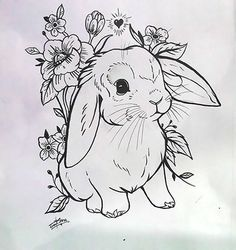 A cute tattoo design of a little rabbit to ink on the girl's skin.