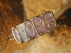 Iridescent Hope Stained Glass and Wire Necklace Pendant  $14.00