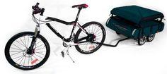 Een vouwwagen achter de fiets