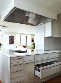 """Lots of smart ideas in this Dwell article """"Top Chef"""" (March 2013), including 18 inches between cooktop and countertop edge to plate dishes and a mini herb garden that sits by a window under grow lamps that run for an hour each day."""