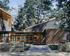 Maine coolness, in a lakefront home :: composed of wood frames, stone walls, copper siding & cedar shingles, this home neatly and organically fits into its surroundings...