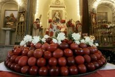Easter Orthodox Eggs being blessed at the altar during Holy Saturday services before Easter Sunday.