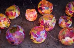 Martinmas Lanterns done with tissue around a balloon (balloon removed). Hang wire from stick to save little hands from heat
