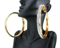 Gold Large Modern Fashion Glitter Hoops Earrings 3.5 Inch Troy Designs. $5.95. Nickel & lead free. Light Weight. Great Quality. 3.5 INCHES. GLITTER GOLD HOOPS