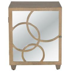 Three interlocking circles of limed oak grace the mirrored door of this modern nightstand. Strong, clean lines get an upgrade with glamorous mirror. The left-opening door is elegantly convenient, enclosing extra storage and a single shelf. #kathykuohome